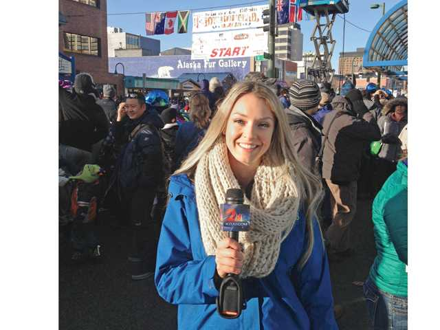 Golden Valley High graduate Beth O'Donnell reports on the 2014 Iditarod, a famous dogsledding race, in Anchorage, Alaska. Photo courtesy of KTUU-TV.