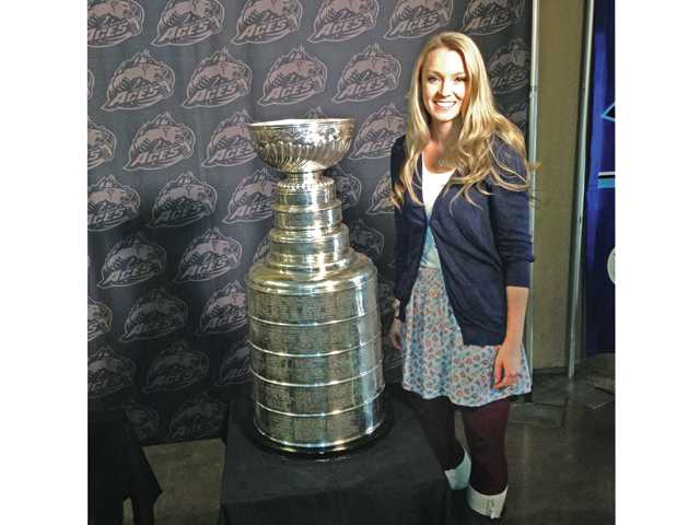 Beth O'Donnell poses with the Stanley Cup while on assignment at an Alaska Aces hockey game in Anchorage. Photo courtesy of KTUU-TV.