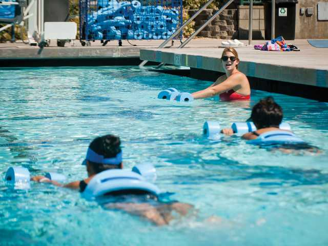 Brandi Tyson leads a water exercise class at the Santa Clarita Aquatics Center on Monday. Signal photo by Charlie Kaijo