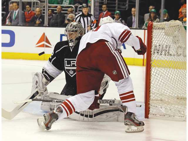 Phoenix Coyotes' Antoine Vermette, right, and Los Angeles Kings' Jonathan Quick (32) battle on Monday in Los Angeles.