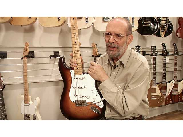 George Gruhn poses with the first production model Fender Stratocaster guitar Tuesday in Nashville, Tenn.