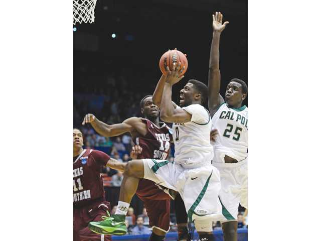 Cal Poly guard Dave Nwaba (0) drives against Texas Southern on Wednesday, in Dayton, Ohio.