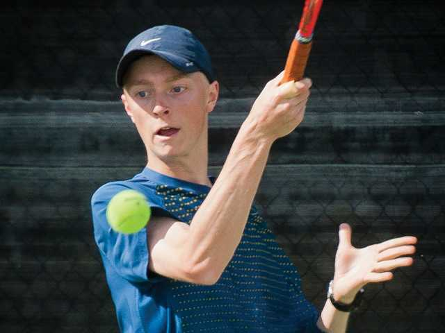 West Ranch's Harrison Collins hits a forehand shot against Hart High on Thursday at hart in the Foothill League opener.
