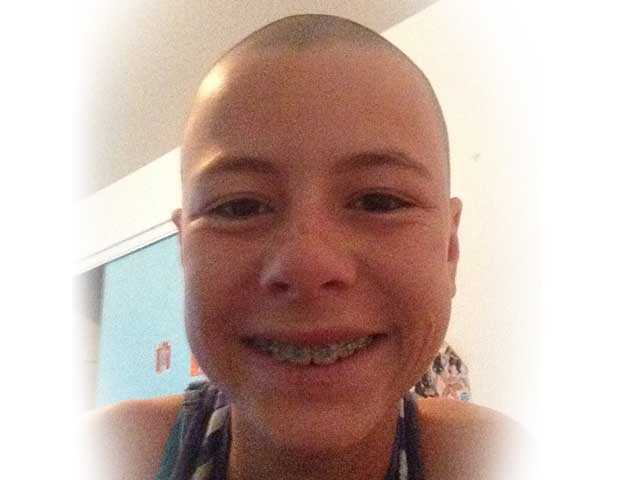 Sarah Cooper after she raised $3,000 by shaving her head for cancer research for children. Courtesy photo