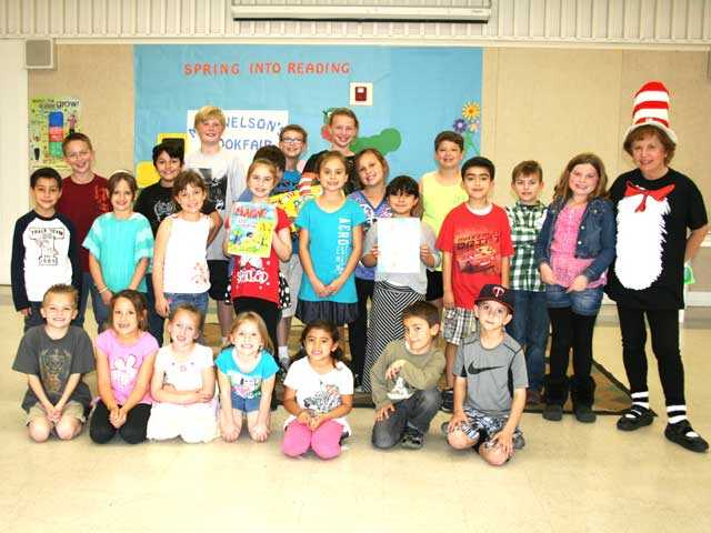 Author Carole Cliffe with children from Skyblue Mesa Elementary students. Courtesy photo