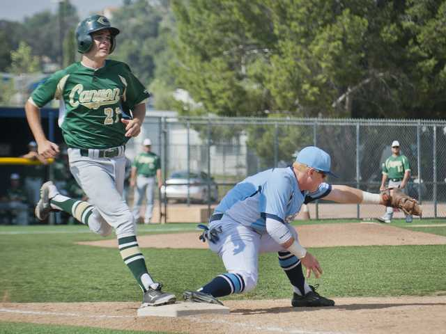 Canyon's Jason Rowe can't beat the throw to Saugus first baseman Ty Faulconer during Friday's game at Saugus High School.