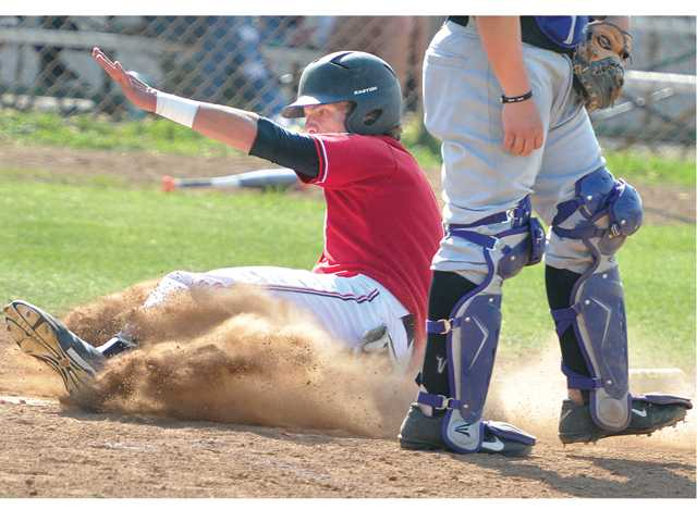 Hart High's Pearson Good (8) slides safely home past Valencia catcher Anthony Lepre on a an RBI double by Weston Fitzpatrick (22) in the 3rd inning against Valencia at Hart on Friday.