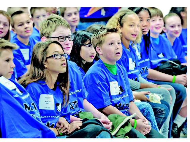 Some of the 180 fourth-, fifth- and sixth-graders at Math Field Day wait for their classroom assignments at Plum Canyon Elementary School in Saugus on Saturday.