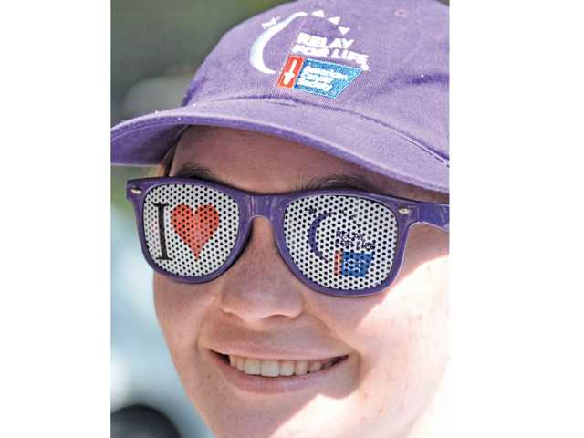 Relay For Life team captain Angela Peach wears her hat and glasses at the Relay For Life kick-off event Saturday.