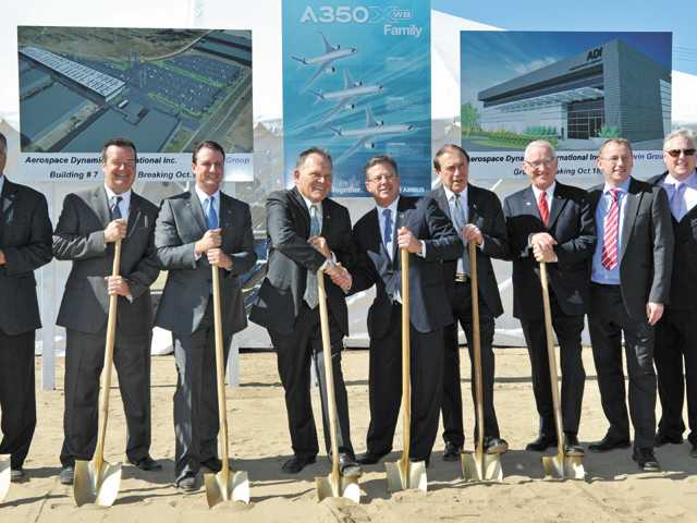 "Company officials and Congressman Howard ""Buck"" McKeon, fourth from right, attend a groundbreaking ceremony for Aerospace Dynamics International's building in Valencia."