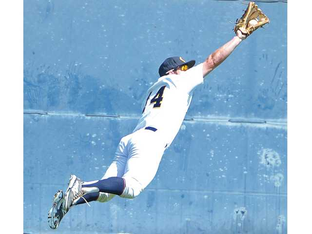 College of the Canyons fielder Nick Vigo makes a flying catch against Glendale College on Saturday.
