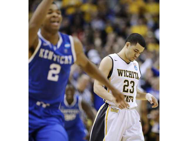 Wichita State guard Fred VanVleet (23) leaves the floor after missing a three-point attempt in the final seconds against Kentucky on Sunday in St. Louis.