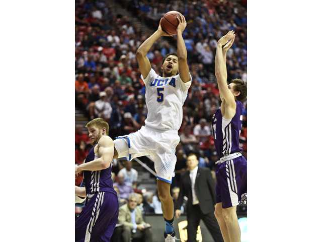 UCLA guard Kyle Anderson (5) goes in for a score during an NCAA tournament game on Sunday in San Diego.