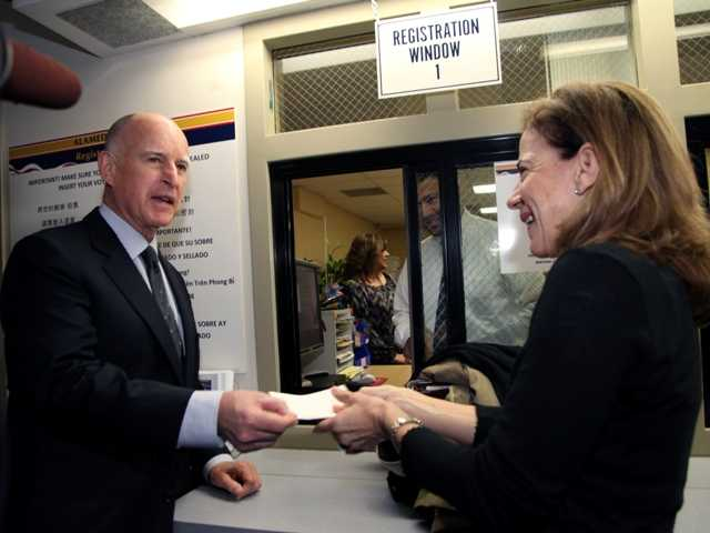 Gov. Jerry Brown reported Monday that he has raised nearly $20 million for his re-election campaign. Above, Brown, with wife Anne Gust Brown filed his papers to seek re-election.