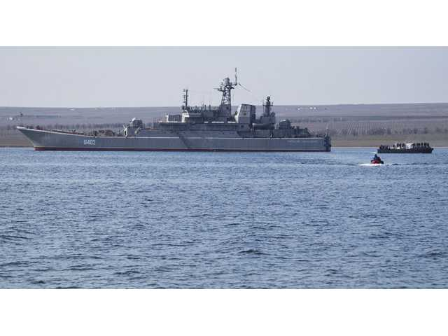 Ukrainian sailors leave the Konstantin Olshansky navy ship in the bay of Donuzlav, Crimea on Monday.