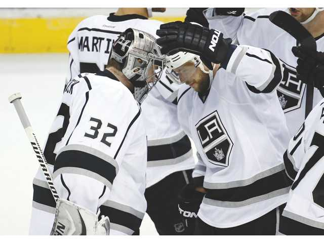 Los Angeles Kings goalie Jonathan Quick (32) celebrates with right wing Marian Gaborik (12) after a win over the Washington Capitals on Tuesday in Washington.