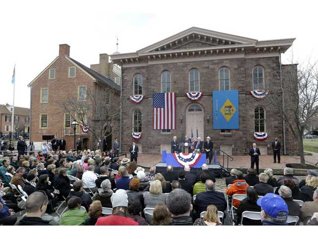 In this March 26, 2013 file photo, Sen. Tom Carper, D-Del. speaks during a ceremony in New Castle, Del. at First State National Monument, which was designated a national monument by President Barack Obama.