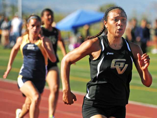 Golden Valley's Azaria Hill competes in the 100-meter dash on March 21, 2013 at West Ranch High School.