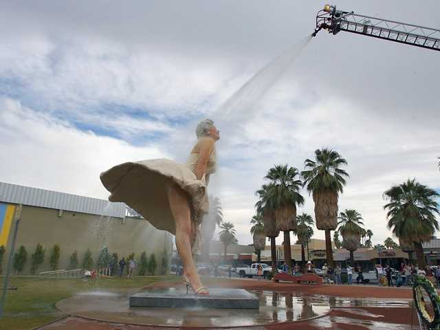 "The scultpure ""Forever Marilyn"" getting a shower from the Palm Springs Fire Department after it stood in the city for two years - on loan from The Sculpture Foundation."