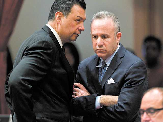 California Senate President Pro Tem Darrell Steinberg, D- Sacramento, right, and Sen. Alex Padilla, D-Pacoima, confer after a vote introducing a resolution to suspend three Democrats who face charges in criminal cases on the floor of the Senate in Sacramento on Friday.