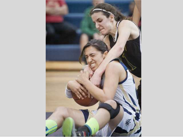 Canyon's Monica Friedl, right, fights for the ball with West Ranch's Chantal Wahba during the SCV Hoops Finale girls game. Friedl was named MVP.