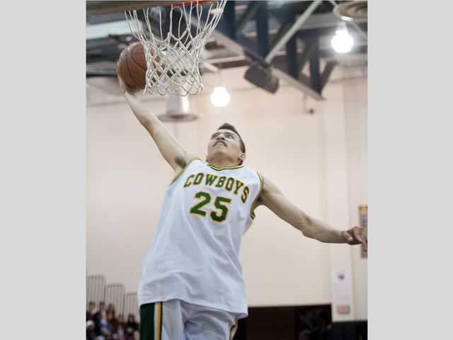 Canyon's Marc Cabrera competes in Saturday's SCV Hoops Finale slam dunk contest at West Ranch High.