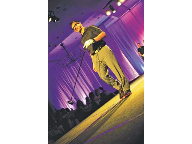 "Oscar Domingue,  vice president and branch manager in Santa Clarita, is the winner of the Male Model Contest at the Soroptimist International of Greater Santa Clarita ""Fashion, Follies and Fun"" fourth annual Fashion Show at the Hyatt Regency Valencia last Sunday afternoon."