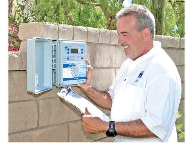 Rene Emeterio, a consultant for Castaic Lake Water Agency, conducts an inspection of a newly installed sprinkler control system. Photo courtesy of Castaic Lake Water Agency.