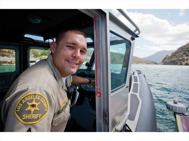 Marine Patrol Deputy Charles Weathers sits in a patrol boat at the Pyramid Sheriff's Dock on Monday.