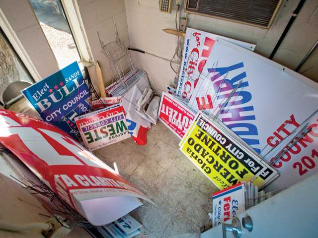City Council campaign signs confiscated for being placed in the public right-of-way. Signal photo by Charlie Kaijo
