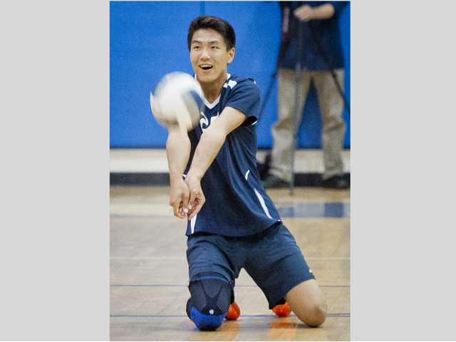 Saugus' Zech Lee digs the ball during Tuesday's game against West Ranch.