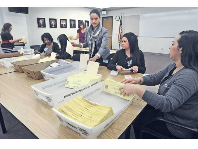 Vote By Mail Ballot Board Inspector Chantelle White, center, and other board members prepare some of the 7.916 Santa Clarita City Council mail-in ballots for counting on Tuesday. The sorting process is open to the public and conducted at the Century Room at Santa Clarita City Hall. Signal photo by Dan Watson
