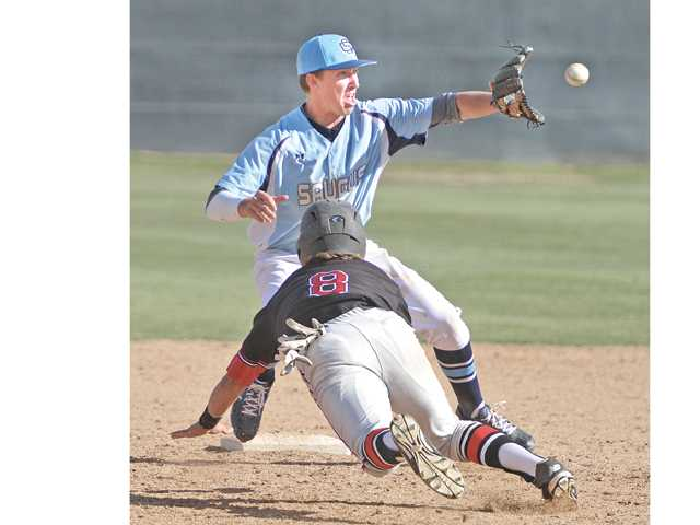 Saugus shortstop Brendan Griffith takes a throw at second base as Hart's Pearson Good slides in on Wednesday at Saugus High School.