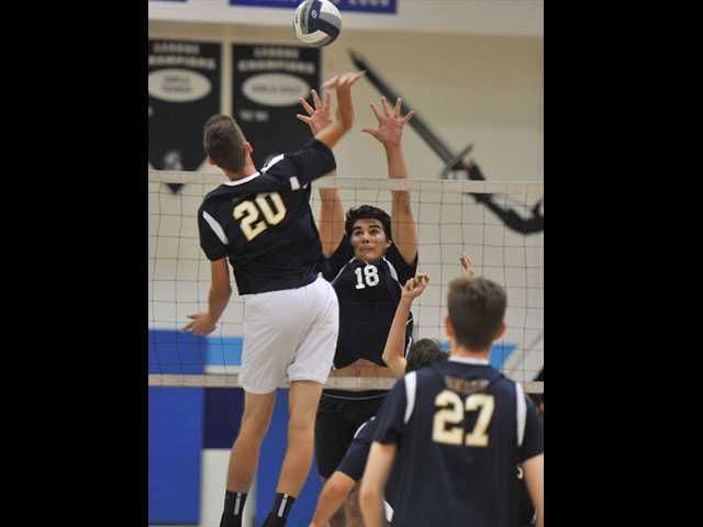 Max Nua goes up for a block against West Ranch's Brett Krahl.