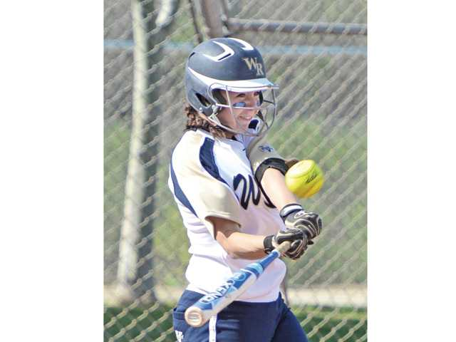 West Ranch's Jessica Harper (9) hits a double in the third inning at West Ranch High School.