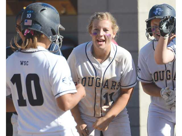 College of the Canyons' Adrianna Correa (10) is met by teammates Kaitlyn Shreves, center, and Nicole Maliniemi after her home run at College of the Canyons on Saturday.