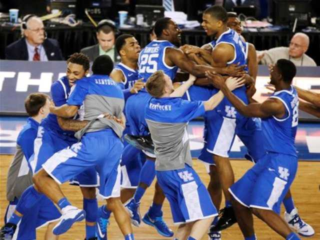 Kentucky celebrates after guard Aaron Harrison made a three-point basket in the final seconds against Wisconsin to win the game 74-73 during their NCAA Final Four tournament college basketball semifinal game Saturday, April 5, 2014, in Arlington, Texas.
