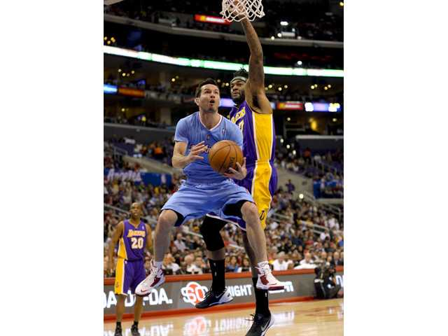Los Angeles Clippers guard J.J. Redick, front, gets by Los Angeles Lakers forward Jordan Hill on Sunday in Los Angeles.