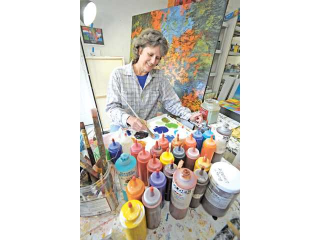 Artist Nancy Eckels in her home studio in Canyon Country.