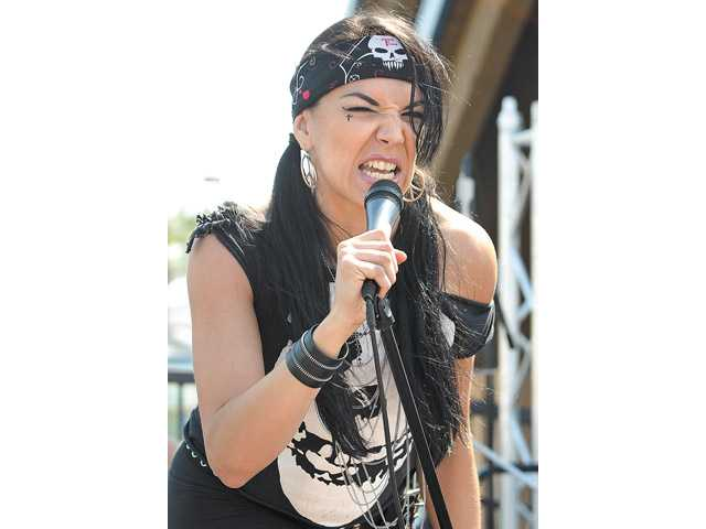 Lead singer Jenna Syde of Jenna Syde & The Watchers sings at a past Summer Meltdown Autism Awareness Art and Music Festival at the city of Santa Clarita Skate Park.