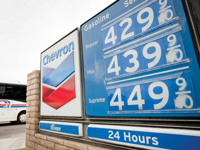 A Chevron gas station sign lists climbing prices for the station on Lyons Avenue in Newhall on Thursday. Signal photo by Charlie Kaijo.