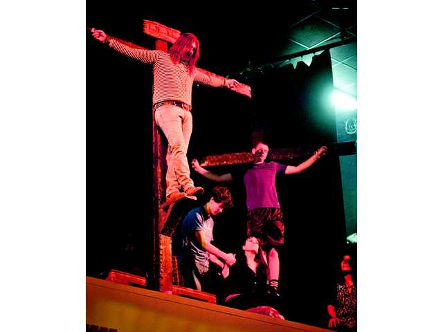 Roger Halston portrays Jesus during a rehearsal of the Grace Baptist Passion play on Thursday. Halston is also the writer and director of the play, his first time filling all three roles.