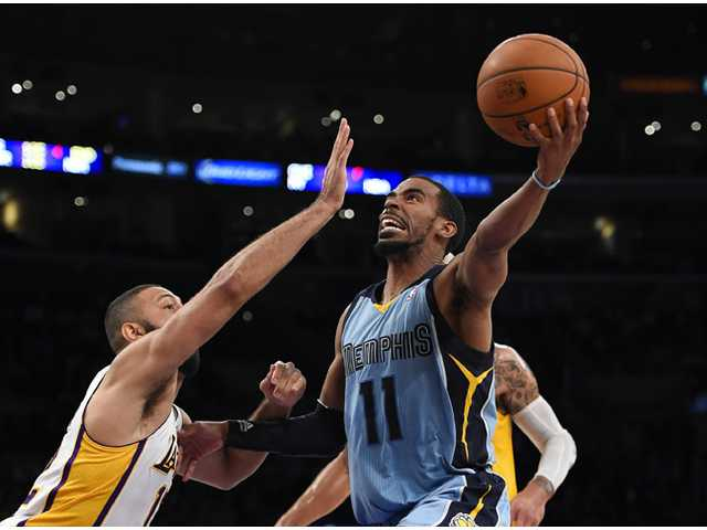 Memphis Grizzlies guard Mike Conley, right, puts up a shot as Los Angeles Lakers guard Kendall Marshall defends on Sunday in Los Angeles.