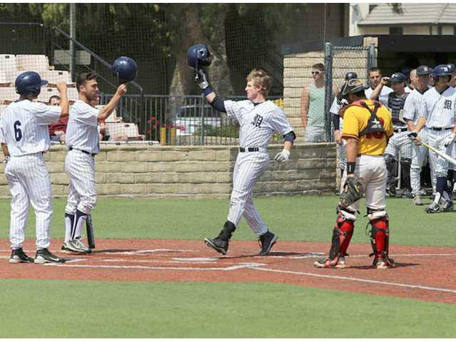 The Master's College baseball players celebrate during a game against Arizona Christian at Reese Field. Photo by Tony Berru.