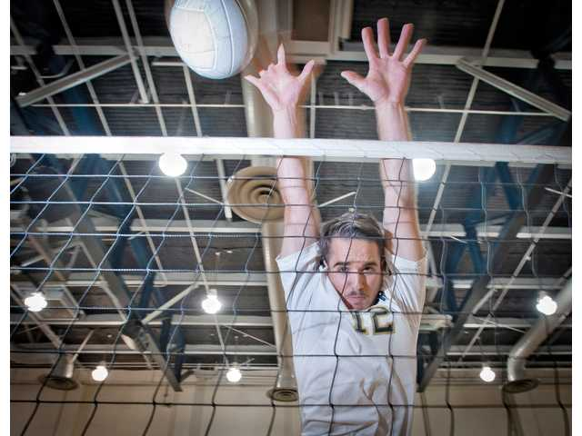 West Ranch senior A.J. Smith is a third-year varsity player who is playing as a middle blocker for the first time.