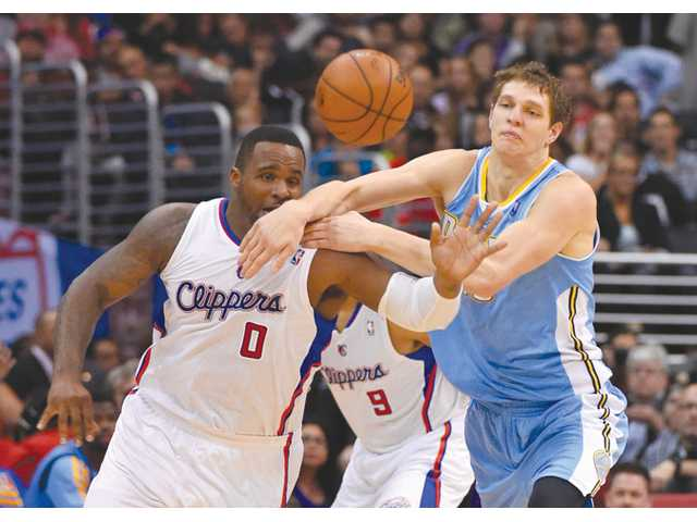 Los Angeles Clippers forward Glen Davis, left, and Nuggets center Timofey Mozgov compete for a loose ball during the first half of Tuesday's Los Angeles.