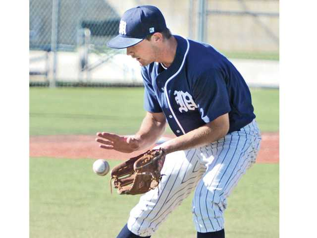 The Master's College pitcher Aaron Alexander fields a ground ball against Bethesda College at TMC on Tuesday.