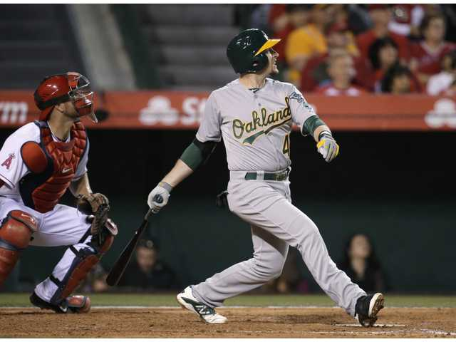 Oakland Athletics' Jed Lowrie watches his RBI double during the third inning against the Los Angeles Angels on Tuesday in Anaheim.