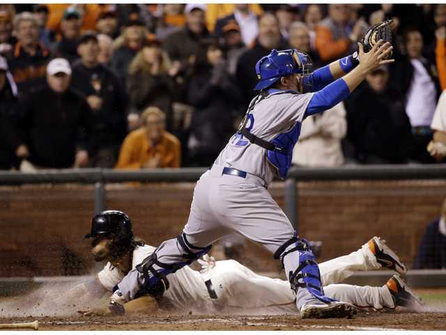 San Francisco Giants' Angel Pagan, bottom, scores under Los Angeles Dodgers catcher Tim Federowicz, top, in the ninth inning on Tuesday in San Francisco.