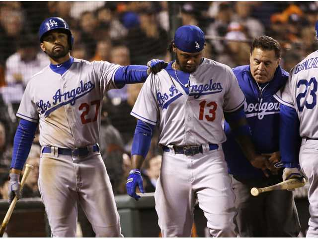 Los Angeles Dodger Hanley Ramirez (13) walks off the field as teammate Matt Kemp (27) gives him a pat on the shoulder on Wednesday in San Francisco.
